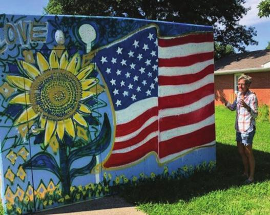 Sunflowers were a regular element as Amy Kern, Washington, started painting the tornado shelters at Colonial Acres this summer. She painted 20 panels around the property.